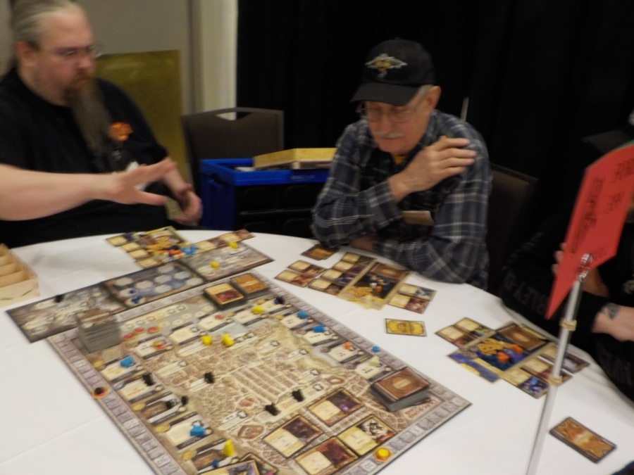 Yes there were Boardgames! I saw Tom Wham at the show waiting to wail on someone in some brutal boardgame action!